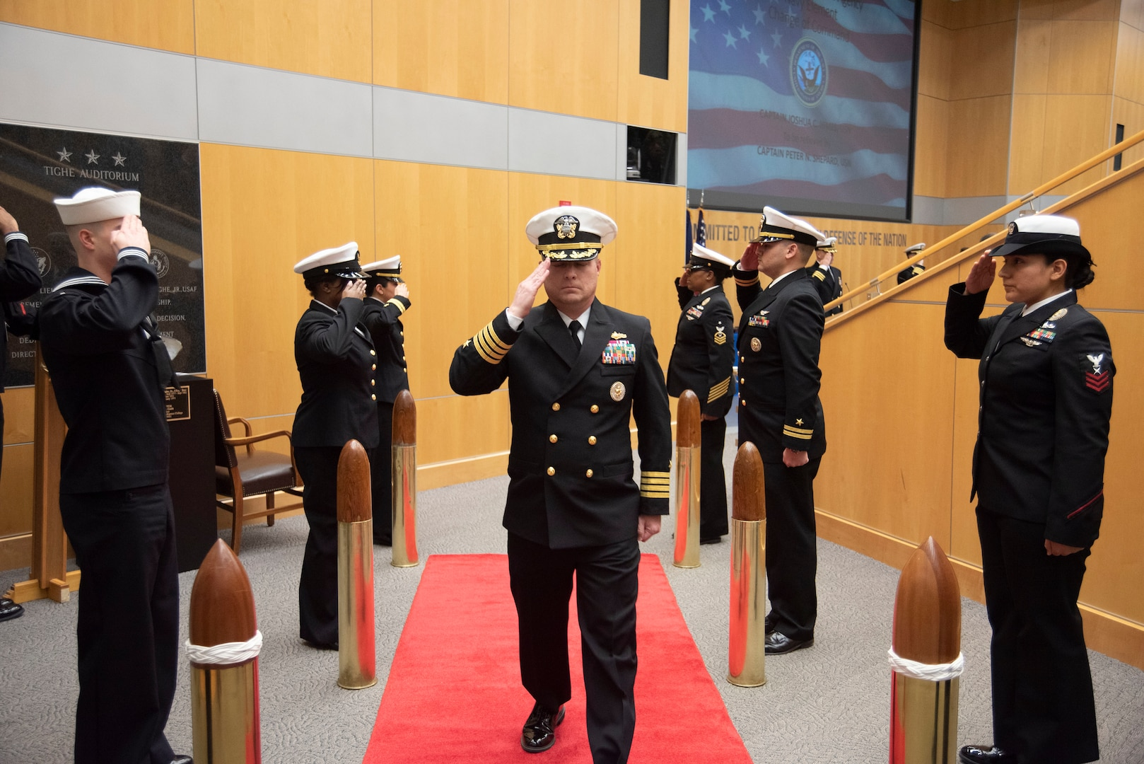 Capt. Peter N. Shepard is piped ashore after becoming the new commander of Defense Intelligence Agency Navy Element during a change of command ceremony, Jan. 30, at the DIA headquarters on Joint Base Anacostia-Bolling.
