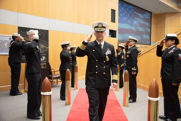 Capt. Joshua C. Himes is piped ashore after relinquishing command of Defense Intelligence Agency Navy Element during a change of command ceremony, Jan. 30, at the DIA headquarters on Joint Base Anacostia-Bolling.