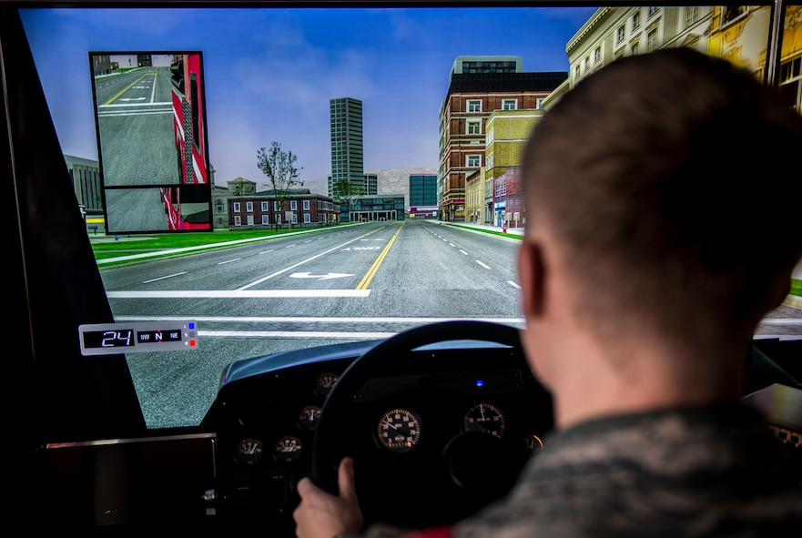 U.S. Air Force Airman 1st Class Jake Hults, a 354th Civil Engineer Squadron firefighter, trains on a driving simulator Jan. 25, 2019, at Eielson Air Force Base, Alaska. The driving simulator teaches Airmen to drive a fire truck in a multitude of environments and road conditions safely. (U.S. Air Force Photo by Senior Airman Isaac Johnson)