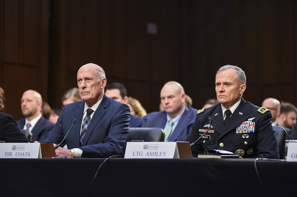 Director of National Intelligence Daniel Coats, left, and Director of the Defense Intelligence Agency Lt. Gen. Robert P. Ashley, Jr. listen to questions from lawmakers during the Worldwide Threat Assessment, Jan. 29, 2019, on Capitol Hill.