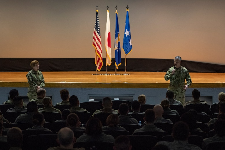 Lt. Gen. Dorothy Hogg, 23rd U.S. Air Force Surgeon General, left, and Chief Master Sgt. G. Steve Cum, Chief of the Medical Enlisted Force, right, speak with the Airmen of the 374th Medical Group during an all call at Yokota Air Base, Japan, Jan. 29, 2019.