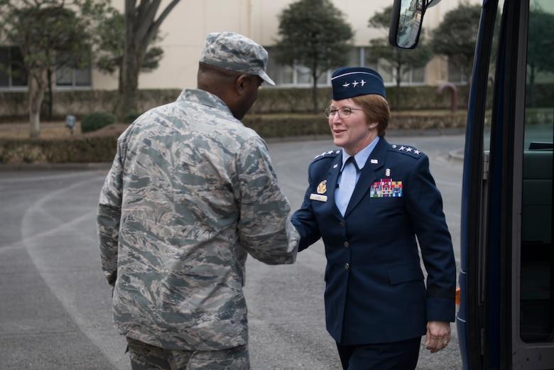 Lt. Gen. Dorothy Hogg, 23rd U.S. Air Force Surgeon General shakes hands with Col. Otis C. Jones, 374th Airlift Wing commander, Jan. 29, 2019, at Yokota Air Base, Japan.
