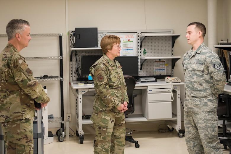 Lt. Gen. Dorothy Hogg, 23rd U.S. Air Force Surgeon General talks with Airmen from the 374th Medical Group Biomedical Equipment Repair shop, Jan. 29, 2019, at Yokota Air Base, Japan.