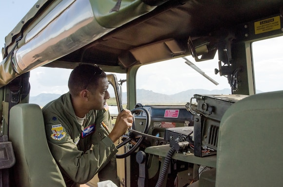 Lt. Col. Erik Smith, a Reserve Citizen Airman C-130H Hercules instructor pilot assigned to the Advanced Airlift Tactics Training Center, operates the Hubbard landing zone during an Advanced Tactics Aircrew Course in Ft. Huachuca, Arizona. (Master Sgt. Erin Hickok)