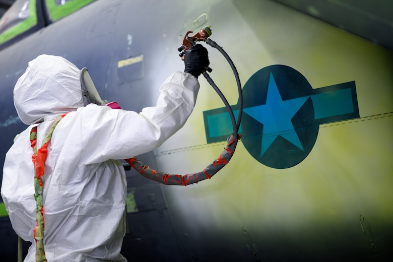 An Airman assigned to the 48th Equipment Maintenance Squadron Corrosion Control Section, paints around a National Star insignia on an F-15E Strike Eagle during a heritage paint job at Royal Air Force Lakenheath, England, Jan. 18, 2019. More than 640 man-hours, across 15 days and $15,000 worth of painting equipment went into the process. (U.S. Air Force photo by Senior Airman Malcolm Mayfield)