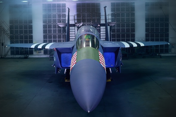 An F-15E Strike Eagle assigned to the 492nd Fighter Squadron is painted in the heritage colors of its World War II P-47 Thunderbolt predecessor at Royal Air Force Lakenheath, England Jan 30. The 48th Fighter Wing officially unveiled the aircraft publicly during a ceremony on Jan 31. (U.S. Air Force photo/Tech. Sgt. Matthew Plew)