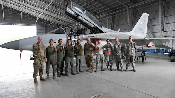U.S. Air Force F-16 Fighting Falcon egress mechanics pose alongside Philippine Air Force FA-50 egress mechanics upon completion of a subject matter expert exchange during Bilateral Air Contingent Exchange-Philippines (BACE-P) at Cesar Basa Air Base, Philippines, Jan. 22, 2019. This is the seventh iteration of BACE-P established by U.S. Pacific Command and executed by Headquarters Pacific Air Forces.