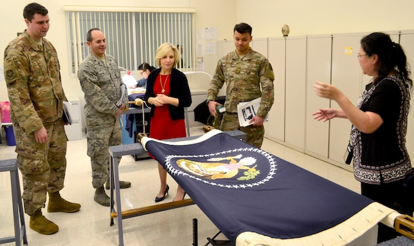 Visitors from the Logistics Officer Association's Pudgy Chapter from Joint Base McGuire-Dix-Lakehurst view a nearly complete, hand embroidered presidential flag in DLA Troop Support's flag room during a tour Jan. 24, 2019 in Philadelphia.