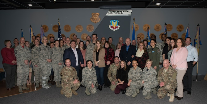 Image of Squadron commanders pose with newly inducted honorary commanders, Jan. 25, 2019, at Mountain Home Air Force Base, Idaho. The intent of the program is to educate local community members about the base and it's mission. (U.S. Air Force photo by Senior Airman Alaysia Berry)