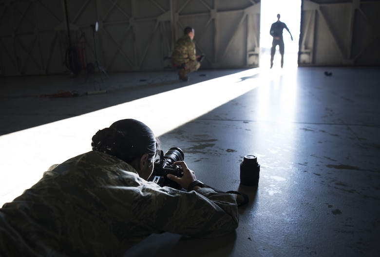 U.S. Air Force Senior Airman Kathryn Reaves, 20th Fighter Wing photojournalist, sets a photo illustration at Shaw Air Force Base, S.C., Jan. 25, 2019.