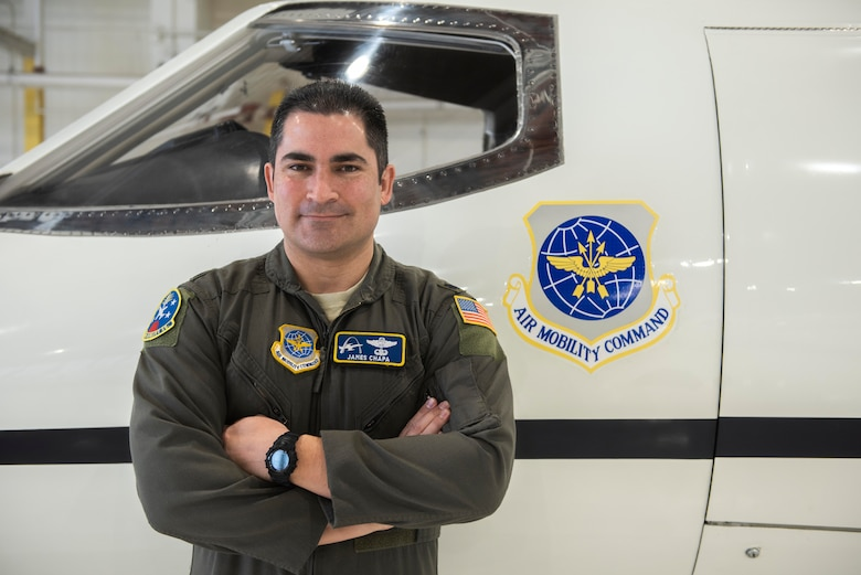 Lt. Col. James Chapa, 458th Airlift Squadron operations officer, poses in front of a legacy C-21 on Jan. 28, 2019 at Scott Air Force Base, Ill. As the operations officer, Chapa is responsible for ensuring coordinating the aircraft's upgrades and training aircrew on the differences between the legacy C-21 and AUP upgraded C-21. One by one, C-21s are being sent to Wichita, Kansas, to receive new avionics and communications suites that will expand the aircraft's reach, effectiveness, and capability.