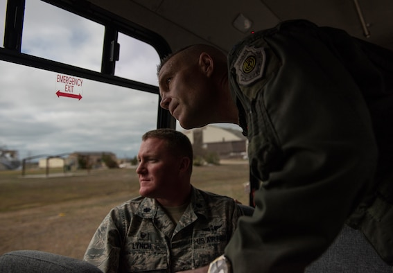 U.S. Air Force Lt. Gen. Steven Kwast, Air Education and Training Command commander, right, and Lt. Col. Michael Lynch, 337th Air Control Squadron commander, view damage on the flightline caused by Hurricane Michael Jan. 24, 2019, at Tyndall Air Force Base, Fla. The 337th ACS sustained damage to several structures during Hurricane Michael. (U.S. Air Force photo by Staff Sgt. Peter Thompson)