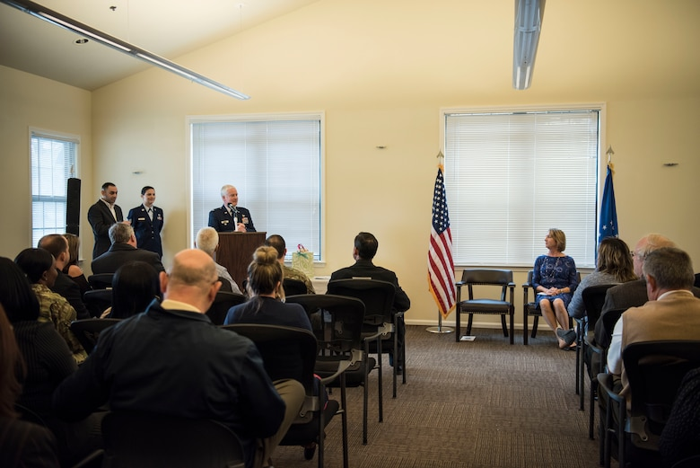 Col. Dale Skinner, Air Force Life Cycle Management Center deputy director of contracting, delivers remarks at Kathy Edenborough's, retirement ceremony Jan. 30, 2019, at the Hunt Community Center on Joint Base Charleston, S.C.