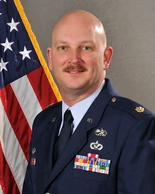The commander of the 182nd Aircraft Maintenance Squadron poses for a portrait.