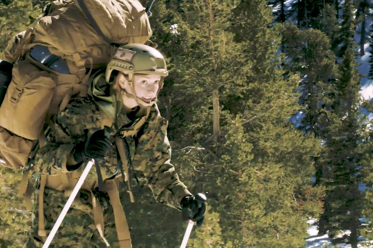Baker skis across a mountain.
