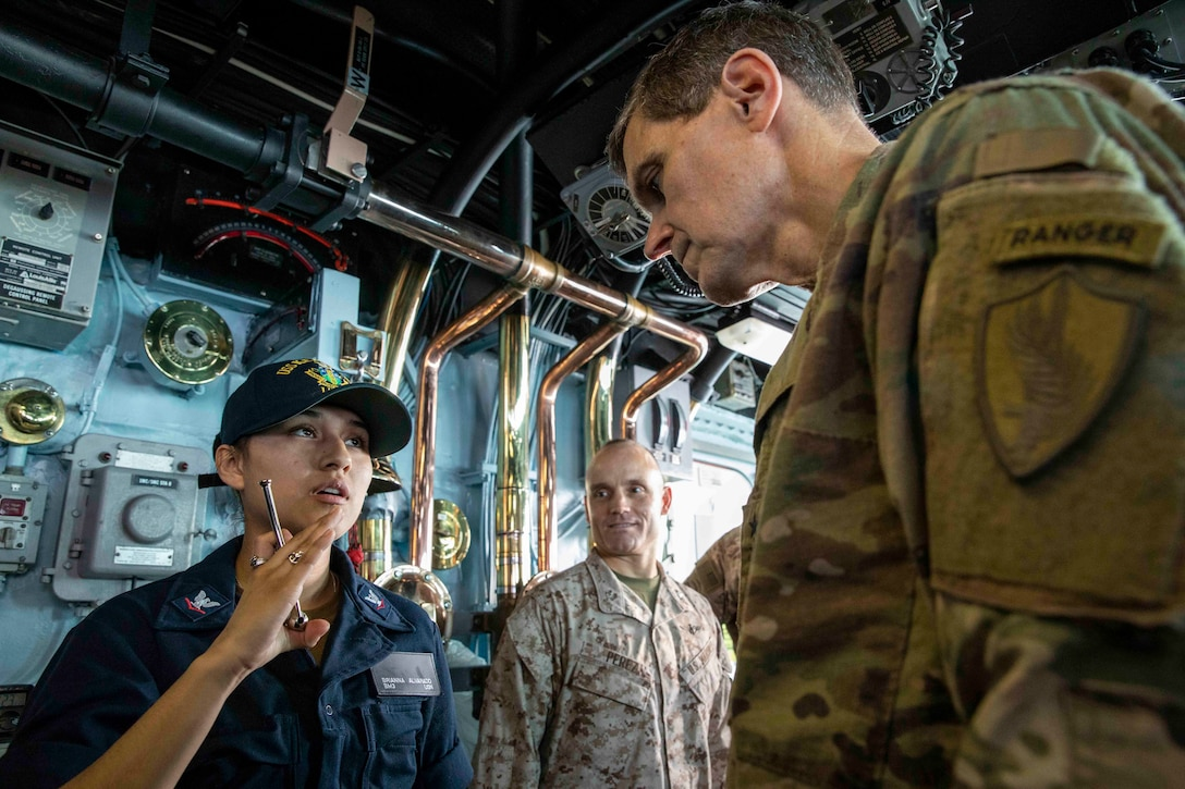 Boatswain's Mate 3rd Class Brianna Alvarado explains her boatswain's pipe to Army Gen. Joseph L. Votel, Commander, U.S. Central Command, in the pilot house of the Wasp-class amphibious assault ship USS Kearsarge (LHD 3). Kearsarge is the flagship for the Kearsarge Amphibious Ready Group and, with the embarked 22nd Marine Expeditionary Unit, is deployed to the U.S. 5th Fleet area of operations in support of naval operations to ensure maritime stability and security in the Central Region, connecting the Mediterranean and the Pacific through the western Indian Ocean and three strategic choke points. (U.S. Navy photo by Mass Communication Specialist 3rd Class Kaitlyn E. Eads/Released)