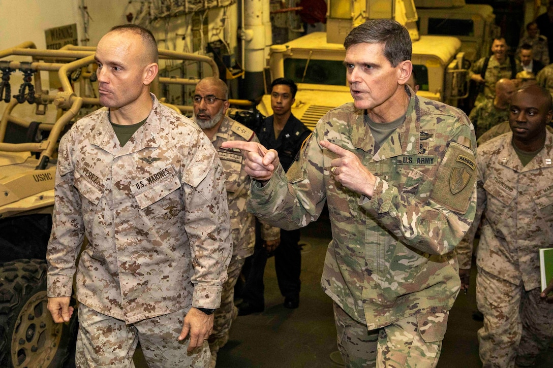 Army Gen. Joseph L. Votel, right, Commander, U.S. Central Command, speaks with Marine Col. Michael Perez, commanding officer of the 22nd Marine Expeditionary Unit, during a tour with Lt. Gen. Ghanem bin Shaheen Al-Ghanem, chief of staff of the Qatar Armed Forces, aboard the Wasp-class amphibious assault ship USS Kearsarge (LHD 3). Kearsarge is the flagship for the Kearsarge Amphibious Ready Group and, with the embarked 22nd MEU, is deployed to the U.S. 5th Fleet area of operations in support of naval operations to ensure maritime stability and security in the Central Region, connecting the Mediterranean and the Pacific through the western Indian Ocean and three strategic choke points. (U.S. Navy photo by Mass Communication Specialist 3rd Class Kaitlyn E. Eads/Released)