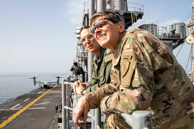 Navy Capt. Jason Rimmer, left, commanding officer of the Wasp-class amphibious assault ship USS Kearsarge (LHD 3), and Army Gen. Joseph L. Votel, Commander, U.S. Central Command, observe flight operations from vulture's row aboard Kearsarge. Kearsarge is the flagship for the Kearsarge Amphibious Ready Group and, with the embarked 22nd Marine Expeditionary Unit, is deployed to the U.S. 5th Fleet area of operations in support of naval operations to ensure maritime stability and security in the Central Region, connecting the Mediterranean and the Pacific through the western Indian Ocean and three strategic choke points. (U.S. Navy photo by Mass Communication Specialist 3rd Class Kaitlyn E. Eads/Released)