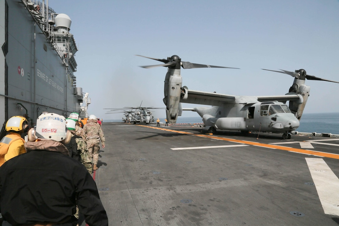 U.S. Army Gen. Joseph Votel, commander, U.S. Central Command, and CENTCOM leaders arrive on the flight deck of the Wasp-class amphibious assault ship USS Kearsarge (LHD 3). Kearsarge is deployed to the U.S. 5th Fleet area of operations in support of naval operations to ensure maritime stability and security in the Central Region, connecting the Mediterranean and the Pacific through the western Indian Ocean and three strategic choke points. (U.S. Army photo by Sgt. Franklin Moore)