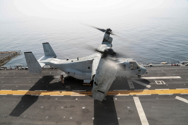 A MV-22 Osprey prepares to launch from the flight deck of the Wasp-class amphibious assault ship USS Kearsarge (LHD 3). Kearsarge is deployed to the U.S. 5th Fleet area of operations in support of naval operations to ensure maritime stability and security in the Central Region, connecting the Mediterranean and the Pacific through the western Indian Ocean and three strategic choke points. (U.S. Army photo by Sgt. Franklin Moore)