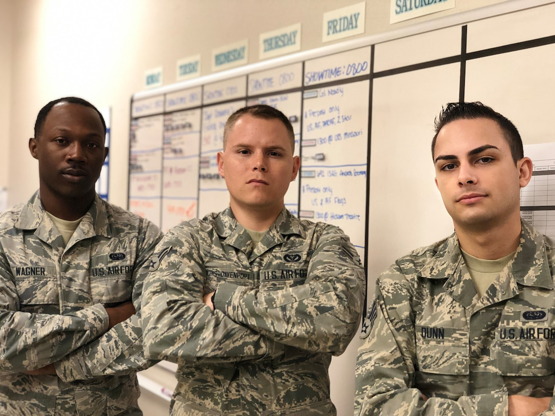 Airman 1st Class Nicholas Wagner, Airman 1st Class Brandon Higgins-Davenport, Senior Airman Robert Dunn, Hickam Field Honor Guard members, pose in front of the whiteboard where they used to schedule their events, Joint Base Pearl Harbor-Hickam, Jan. 30, 2019. With help from the Aloha Spark team, the Honor Guard team developed a scheduling system that consolidates multiple databases and streamlined the scheduling process. (Courtesy Photo)