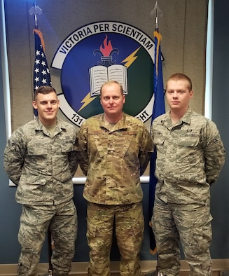 (Left to right) Airman 1st Class Garrett Starr, Iowa Air National Guard's 132nd Operations Group, Master Sgt. J. Garrett Palmer, Florida ANG's 131st Training Flight, and Airman 1st Class Phillip Turney, Texas ANG's 209th Weather Flight, pose for a picture after winning the Thor's Legion Forecast Challenge, an Air Force level competition that tests the forecasting capabilities of Airmen across the weather community.