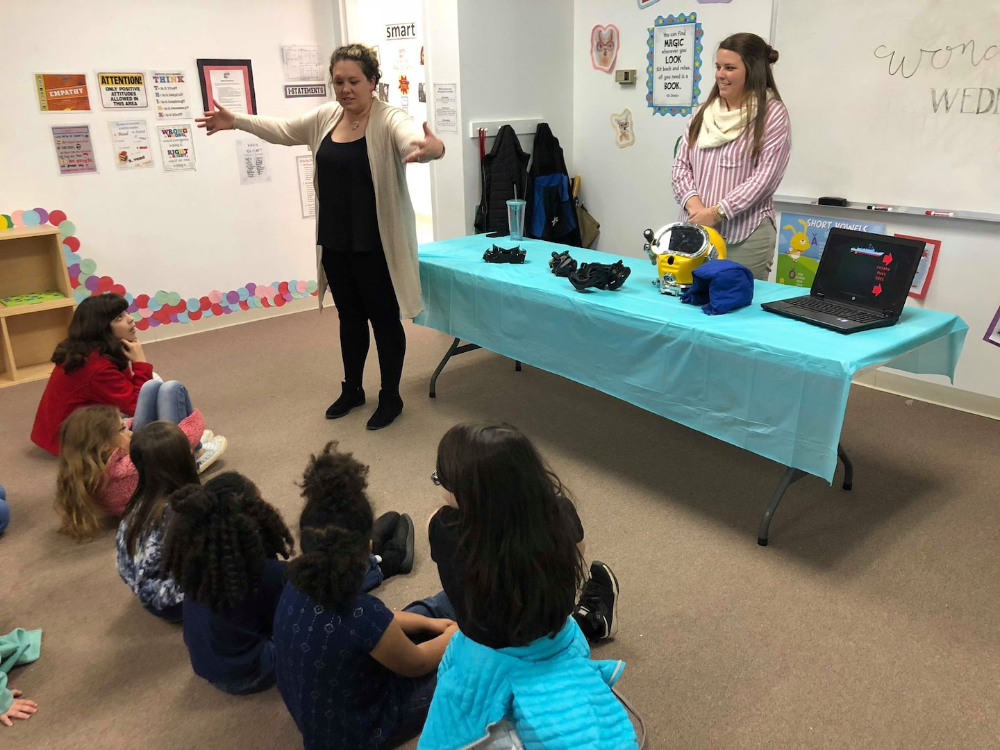 Naval Surface Warfare Center Panama City Division Science, Technology, Engineering, and Mathematics (STEM) Outreach Programs Manager Paige George (left) and Mechanical Engineer Allie Williams (right) describe diving and life support systems capabilities at a Girls Inc. STEM outreach event Jan. 30, 2019. U.S. Navy photo by Katherine Mapp