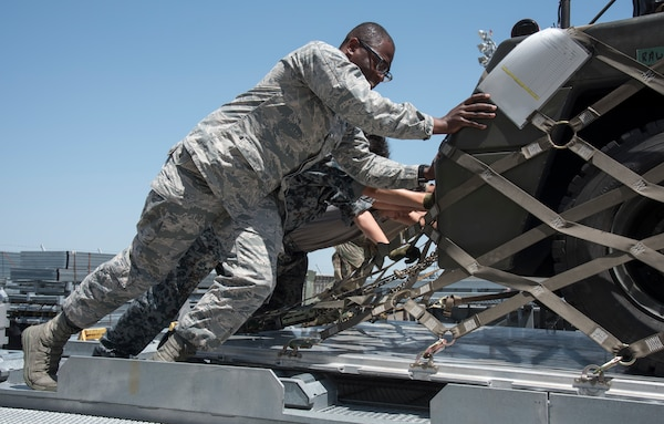 U.S. Air Force and Japan Air Self-Defense Force personnel push a supply pallet together into a loading truck at Misawa Air Base, Japan, May 25, 2019. The supply pallets included both U.S. Air Force and JASDF supplies for exercise RED FLAG-Alaska 19-2 exercise. (U.S. Air Force photo by Branden Yamada)