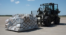 U.S. Air Force Staff Sgt. Tristan Caro, a 35th Logistics Readiness Squadron air transportation journeyman, moves a supply pallet at Misawa Air Base, Japan, May 25, 2019. Supplies are part of a U.S. and Japan Air Self-Defense Force bilateral cargo movement which supply military members with the necessary training equipment to participate in RED FLAG-Alaska 19-2. (U.S. Air Force photo by Branden Yamada)