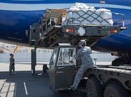U.S. Air Force and Japan Air Self Defense Force personnel load supplies headed for RED FLAG-Alaska 19-2 into a Boeing 747 at Misawa Air Base, Japan, May 25, 2019. The bilateral coordination of cargo included 35th Logistics Readiness Squadron, PACAF Air Mobility Command, JASDF and the 35th munitions flight. (U.S. Air Force photo by Branden Yamada)