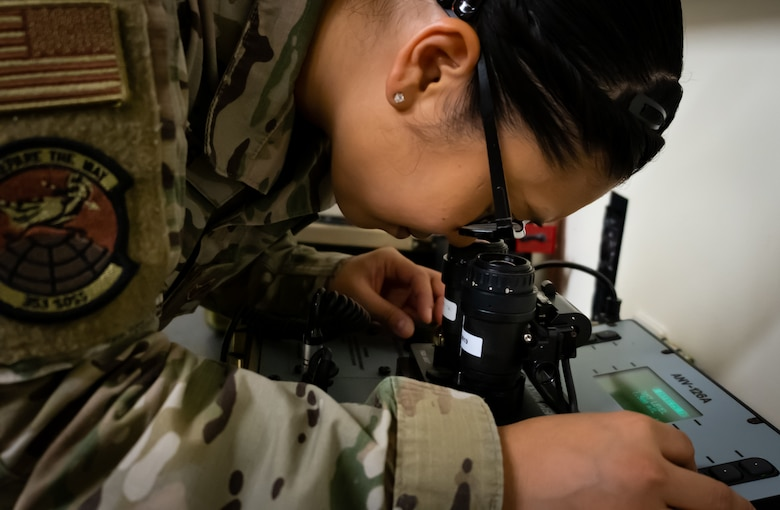 Airman 1st Class Samira Trimas, Aircrew Flight Equipment technician assigned to the 353rd Special Operations Support Squadron, inspects night vision goggles on Kadena Air Base, June 25, 2019.