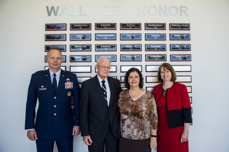 Inductees and honored guests pose for a photo in front of the Wall of Honor at the Air Force Technical Applications Center at Patrick AFB, Fla., April 30, 2019.  Pictured from right to left:  Col. Chad Hartman, AFTAC commander; Col. (ret.) Franklin D. Hall, inductee; Donna Jean, wife of inductee Dr. George H. Rothe III; and Doris Bruner, an AFTAC technical advisor who accepted the award for Lt. Col. (ret) Michael MacInnes.  (U.S. Air Force photo by Jared Trimarchi)