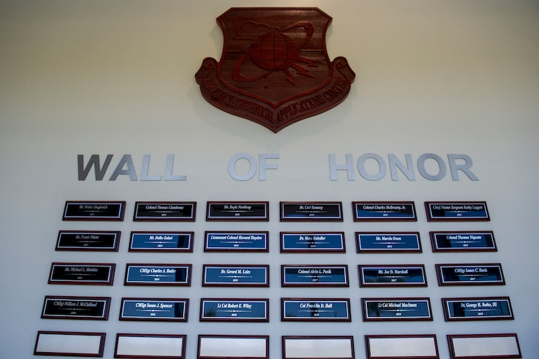A photo of the Air Force Technical Applications Center Wall of Honor plaques that adorn the lobby of the nuclear treaty monitoring center at Patrick AFB, Fla.  (U.S. Air Force photo by Jared Trimarchi)