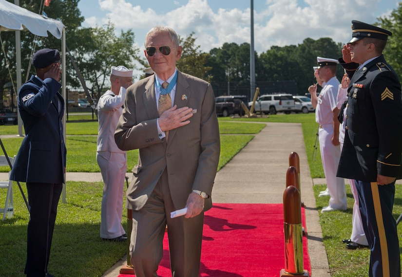 Retired U.S. Marine Corps Maj. Gen. James Livingston, Medal of Honor recipient and guest speaker, arrives during a change of command ceremony June 28, 2019, Joint Base Charleston Naval Weapons Station, S.C. During the ceremony, Cmdr. Jack Garcia relieved Cmdr. Carl Brobst as commanding officer of Naval Consolidated (NAVCON) Brig Charleston. Garcia was previously the executive officer for NAVCON Brig Charleston. Brobst will be transferring Center for Surface Combat Systems Detachment, Mayport, Fla. NAVCON Brig Charleston's mission is to ensure the security, good order and discipline, safety of adjudged and pretrial prisoners, and detain enemy combatants in accordance with guidance from the president through the secretary of defense. NAVCON Brig Charleston also aims to retrain and restore the maximum number of prisoners to honorable service and prepare members to be productive citizens outside of the military.
