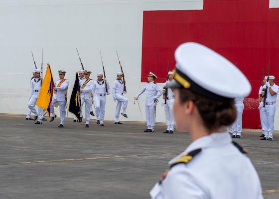 Ecuadorian service members parade their colors.