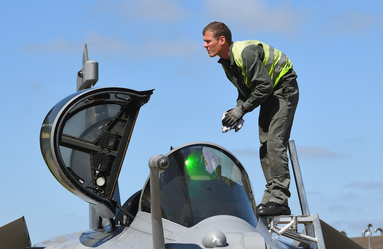 A French Air Force maintainer cleans the windscreen of a Rafale during exercise Point Blank 19-2 at Royal Air Force Lakenheath, England, June 17, 2019. Point Blank is a trilateral exercise focused on fourth and fifth-generation aircraft integration. (U.S. Air Force photo by Staff Sgt. Alex Fox Echols III/Released)