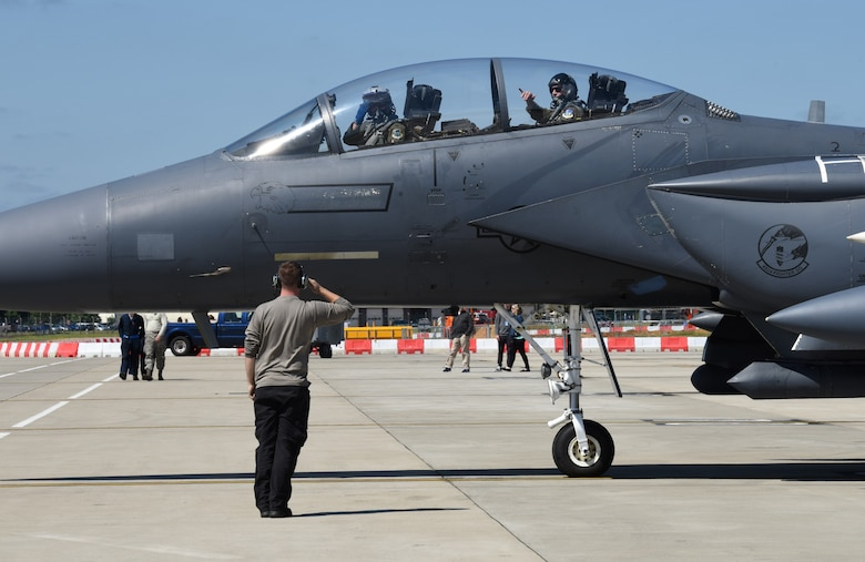 An aircraft maintainer, assigned to the 48th Maintenance Group, renders a salute to an F-15E Strike Eagle pilot before takeoff during Point Blank 19-2 at Royal Air Force Lakenheath, England, June 27, 2019. Approximately 52 aircraft from the U.S., France, and the U.K. participated in the exercise. (U.S. Air Force photo by Airman 1st Class Rhonda Smith)