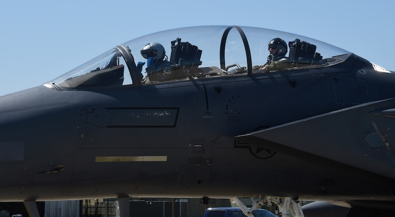 An F-15E Strike Eagle aircrew assigned to the 494th Fighter Squadron prepares to take off for exercise Point Blank 19-2 at Royal Air Force Lakenheath, England, June 27, 2019. U.S. personnel from RAF Lakenheath and RAF Mildenhall, England, along with military members from the U.K. and France participated in the exercise, promoting multinational cooperation. (U.S. Air Force photo by Airman 1st Class Rhonda Smith)