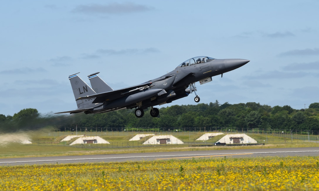 A 492nd Fighter Squadron F-15E Strike Eagle takes off during exercise Point Blank 19-2 at Royal Air Force Lakenheath, England, June 27, 2019. This trilateral exercise provides a low-cost initiative designed to increase the tactical proficiency of participating air forces. (U.S. Air Force photo by Airman 1st Class Rhonda Smith)