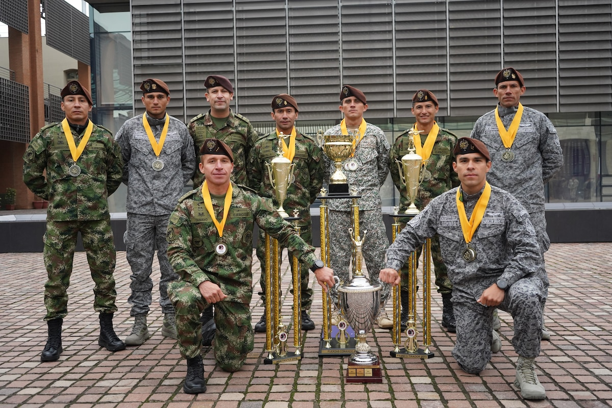 Comandos Colombia pose with their trophy after a closing ceremony held for Fuerzas Comando 2019.