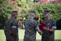 U.S. Marine Corps Col. Thomas H. Campbell III, right, the outgoing commanding officer of Headquarters and Service Battalion, U.S. Marine Corps Forces Command, is awarded the Legion of Merit during a change of command ceremony at Naval Support Activity Hampton Roads, Virginia, June 27, 2019.