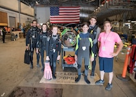 Students from Gulf Coast State College and Gulf Coast High School stand with one of the submarines at the International Human-Powered Submarine Races (ISR) on June 24, 2019.