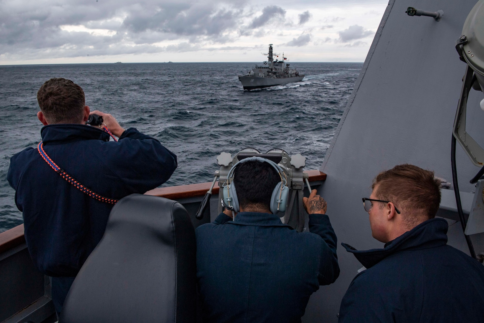 Sailors aboard USS Michael Murphy as Chilean Navy frigate CNS Almirante Condell passes alongside.
