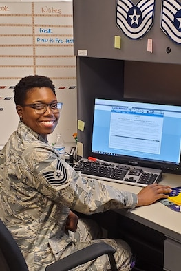 U.S. Air Force Tech. Sgt. Neosha Benson smiles while going about her daily duties as the 307th Force Support Squadron unit training manager at Barksdale Air Force Base, Louisiana (date).  Leadership from the 307th FSS nominated Benson for this year's Bossier Chamber of Commerce Patriot Award. (courtesy photo)