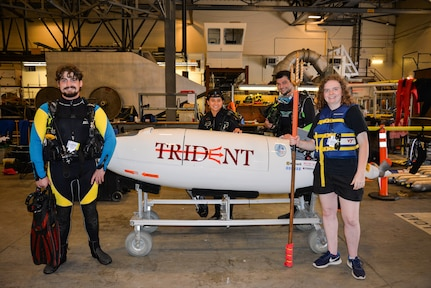 The Trident, one of the submarines designed and built by Virginia Tech engineering students, gets ready to launch for the first races of the day in Naval Surface Warfare Center, Carderock Division's 3,200-foot indoor tow tank on June 25