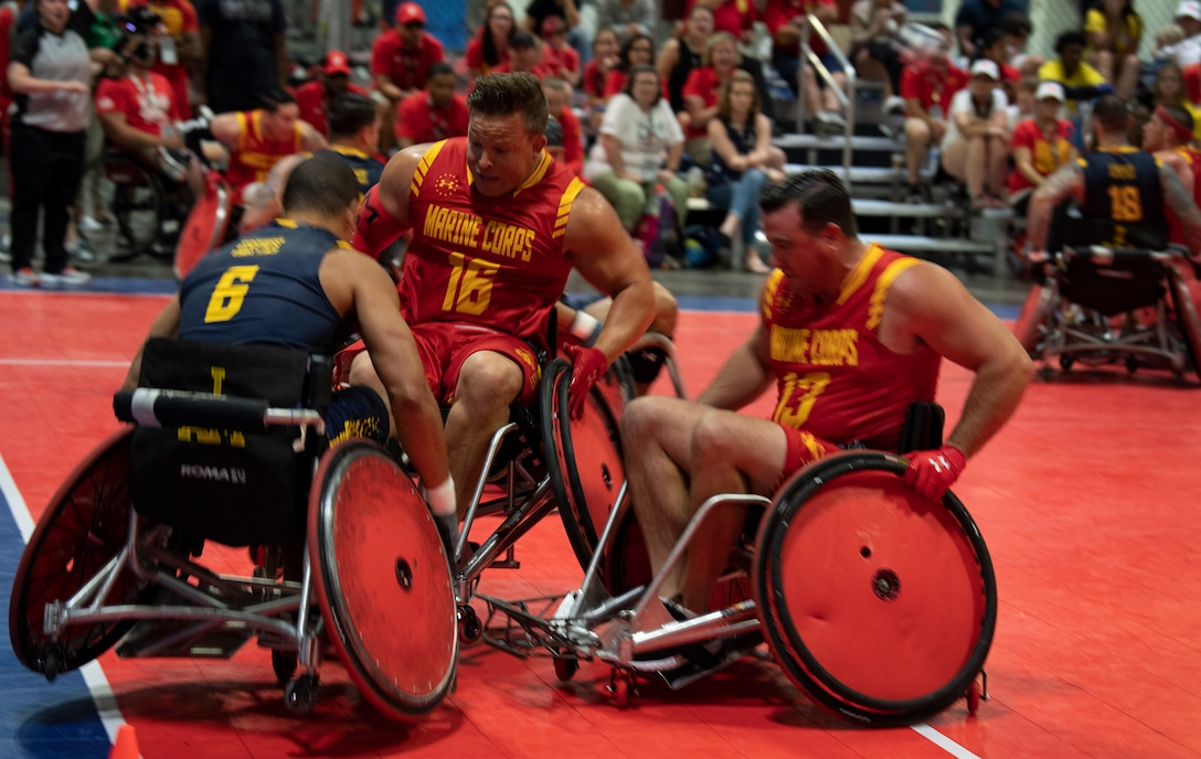 A U.S. Marine Corps wheelchair rugby team defends against team Navy at the DoD Warrior Games in Tampa, Florida, June 27, 2019. The Warrior Games showcase the resilient spirit of today's wounded, ill or injured service members from all branches of the military and provide a venue for recovering service members and veterans to demonstrate triumph over significant physical or invisible wounds and injuries.