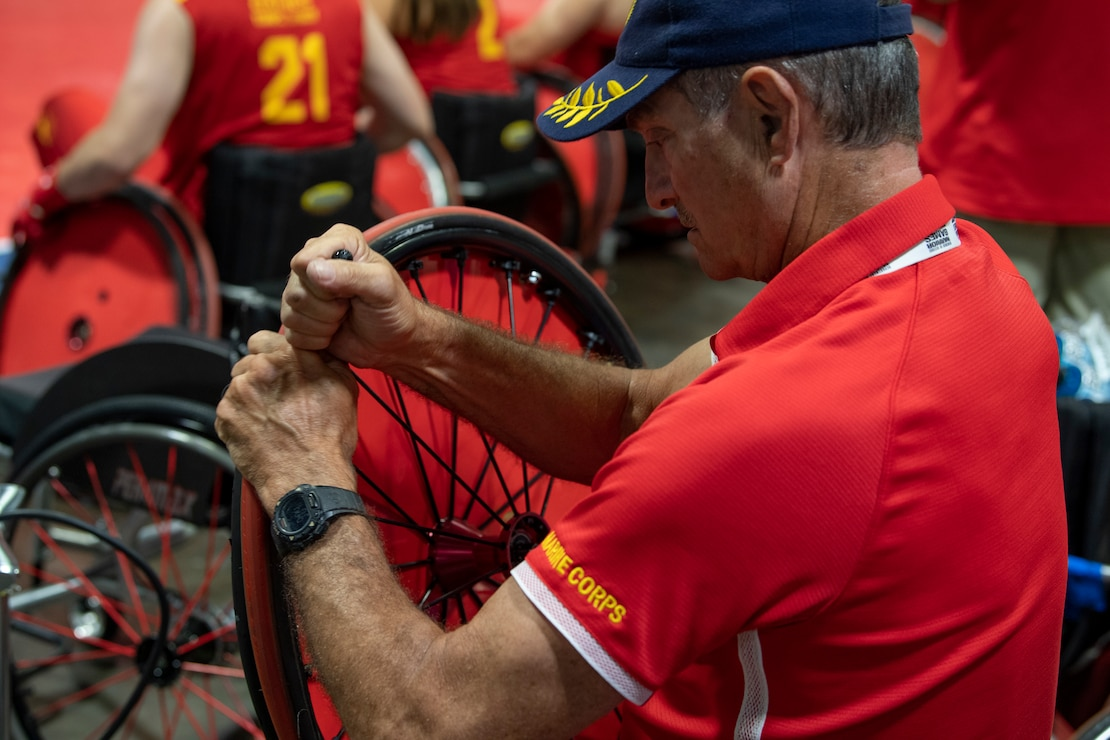 A U.S. Marine Corps team staff member checks the equipment functionality at the DoD Warrior Games wheelchair rugby competition in Tampa, Florida, June 27, 2019. The DoD Warrior Games is an adaptive sports competition for wounded, ill and injured service members and veterans. The 2019 Warrior Games consist of 13 Paralympic-style sports, and more than 300 athletes representing the U.S. Marine Corps, Army, Navy, Air Force, Special Operations Command, and five international teams.