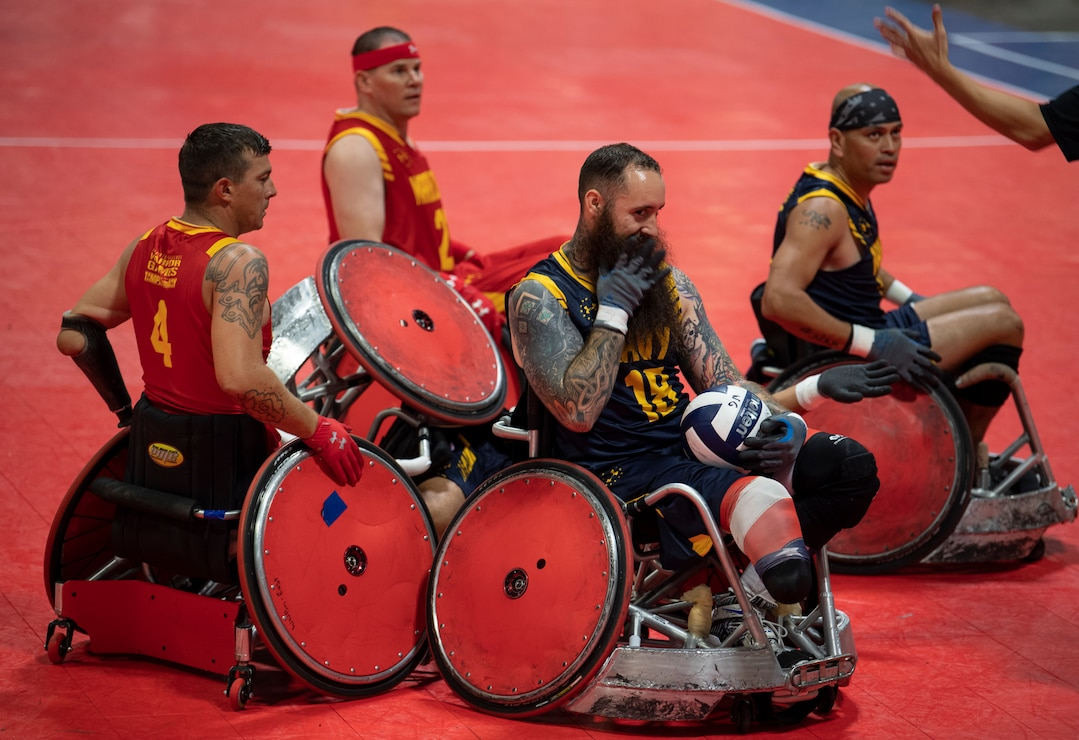 U.S. Marine Corps and Navy wheelchair rugby teams get caught in a collision at the DoD Warrior Games in Tampa, Florida, June 27, 2019. The DoD Warrior Games showcase the resilient spirit of today's wounded, ill or injured service members from all branches of the military and provide a venue for recovering service members and veterans to demonstrate triumph over significant physical or invisible wounds and injuries.