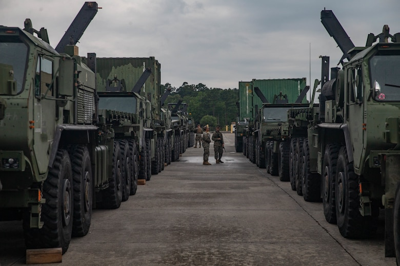 U.S. Marines with 2nd Transportation Support Battalion, Combat Logistics Regiment 2, 2nd Marine Logistics Group, clean the inside of vehicles while staged to be loaded on to the USNS Watkins during exercise Resolute Sun at Joint Base Charleston, South Carolina, June 11, 2019. Marines participated in the exercise to increase major combat operational readiness in amphibious and prepositioning operations while conducting joint training with the U.S. Army during a joint logistics over the shore scenario.