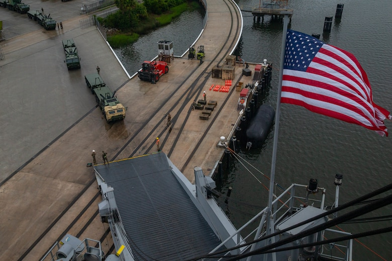 U.S. Marine Corps logistics vehicles system replacements from 2nd Transportation Support Battalion, Combat Logistics Regiment 2, 2nd Marine Logistics Group, load onto the USNS Watkins during an on load port operation as part of exercise Resolute Sun at Joint Base Charleston, South Carolina, June 12, 2019. Marines participated in the exercise to increase combat operational readiness in amphibious and prepositioning operations while conducting joint training with the U.S. Army during a joint logistics over the shore scenario.